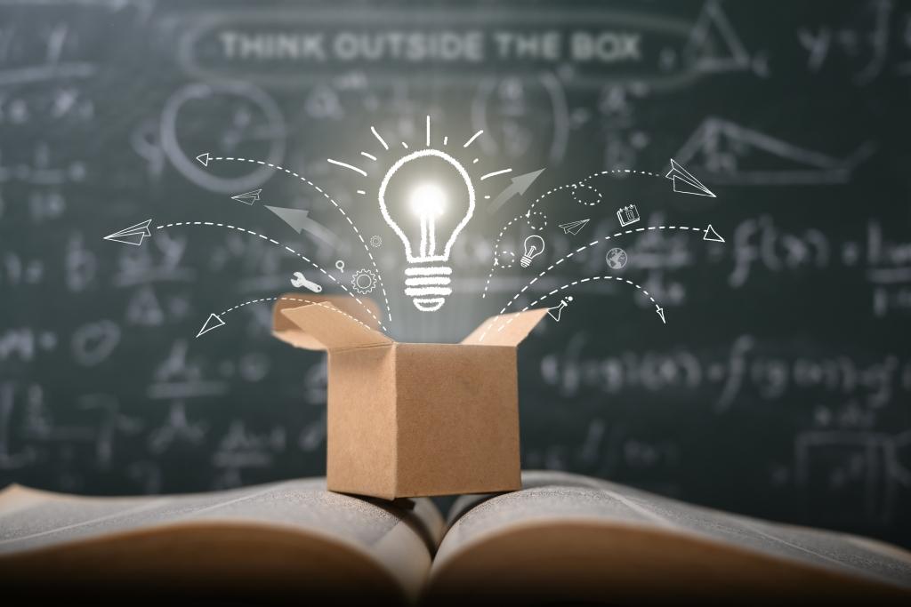 Idea lightbulb over a box